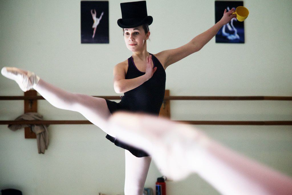 "Isabel Kovacs rehearses her role as ""The Mad Hatter"" - photo by Troy R. Bennett"